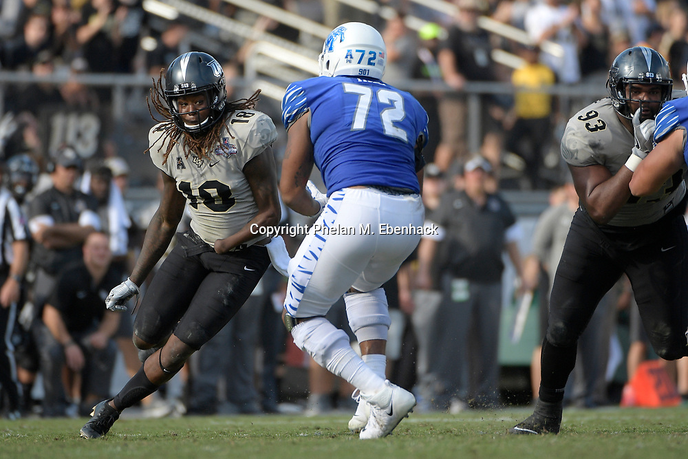 Central Florida linebacker Shaquem Griffin (18) works against Memphis offensive lineman Trevon Tate (72) during the second half of the American Athletic Conference championship NCAA college football game Saturday, Dec. 2, 2017, in Orlando, Fla. Central Florida won 62-55. (Photo by Phelan M. Ebenhack)