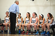 Mount Mansfield head coach Marty Derda talks to the his team on the bench during the girls basketball game between the Rice Green knights and the Mount Mansfield Cougars at MMU High School on Friday night December 4, 2015 in Jericho. (BRIAN JENKINS/for the FREE PRESS)