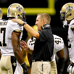 September 9, 2012; New Orleans, LA, USA; New Orleans Saints defensive coordinator Steve Spagnuolo talks with safety Malcolm Jenkins (27)  during the second half of a game against the Washington Redskins at the Mercedes-Benz Superdome. The Redskins defeated the Saints 40-32. Mandatory Credit: Derick E. Hingle-US PRESSWIRE