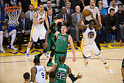 Golden State Warriors forward Draymond Green (23) passes the ball against the Boston Celtics defense at Oracle Arena in Oakland, Calif., on March 8, 2017. (Stan Olszewski/Special to S.F. Examiner)