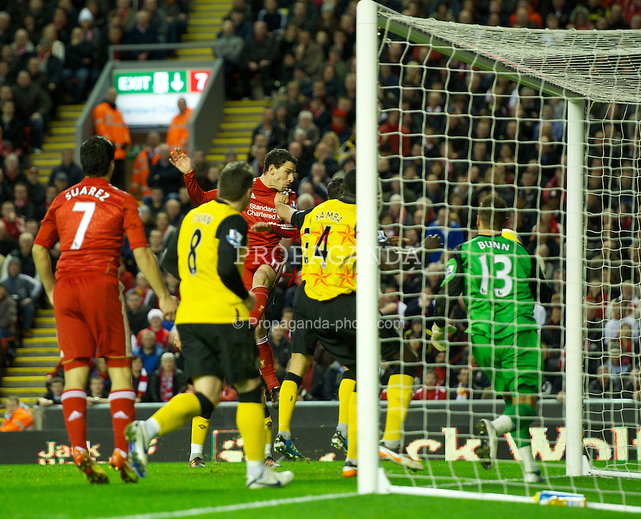 LIVERPOOL, ENGLAND - Boxing Day Monday, December 26, 2011: Liverpool's Luis Alberto Suarez Diaz scores the equalising goal against Blackburn Rovers to level the scores 1-1 during the Premiership match at Anfield. (Pic by David Rawcliffe/Propaganda)