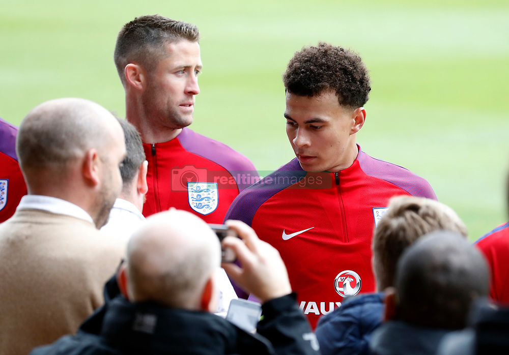 England's Dele Alli and Gary Cahill after the training session at St George's Park, Burton.