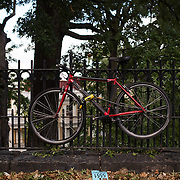 October 4, 2016 - New York, N.Y. : A bicycle is chained to a fence along St. Nicholas Terrace, by the Grove School of Engineering building at the <br /> City College of New York on Tuesday afternoon, October 4. <br /> CREDIT: Karsten Moran for The New York Times