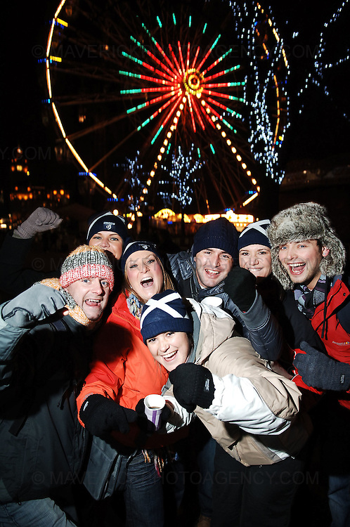 EDINBURGH, UK. Early revellers hit Princes Street in Edinburgh leading up to the bells at midnight...Pic shows from left, Ross Edwards, Donna Kyle, Leah Whitehead, Lyndsay Ethell, Dave O'Connor, Lisa Squire and Jamie Slater all from Blackpool up for Hogmanay...Picture Richard Scott/Maverick