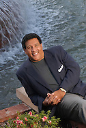 Television sports commentator Greg Gumbel sits at the base of a fountain near his home in Winter Springs, Florida.