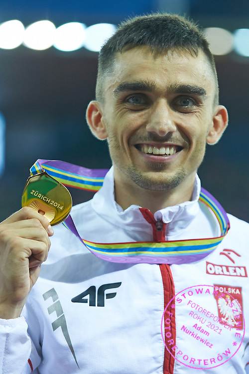 Adam Kszczot from Poland poses with gold medal in men's 800 meters final during the Fourth Day of the European Athletics Championships Zurich 2014 at Letzigrund Stadium in Zurich, Switzerland.<br /> <br /> Switzerland, Zurich, August 15, 2014<br /> <br /> Picture also available in RAW (NEF) or TIFF format on special request.<br /> <br /> For editorial use only. Any commercial or promotional use requires permission.<br /> <br /> Photo by &copy; Adam Nurkiewicz / Mediasport