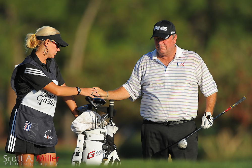 Mark Calcavecchia and his caddie second round of the Honda Classic at PGA National on March 2, 2012 in Palm Beach Gardens, Fla. ..©2012 Scott A. Miller.