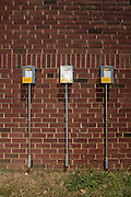 University Park, Maryland - May 04, 2015: Three power terminals line the outside wall of the University Park Church of the Brethren in University Park, Maryland Monday May 4th, 2015. The church uses a 22 kilowatt solar electric array owned by University Park Community Solar, LLC.  The solar panels on top of the church produce an estimated 25% more energy than the church needs per year. Members of the LLC who helped pay for the solar panels receive dividends based on the money they invested, but no energy. <br /> <br /> CREDIT: Matt Roth