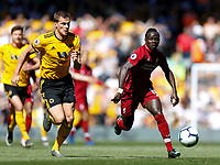 Football - 2018 / 2019 Premier League - Liverpool vs. Wolverhampton Wanderers <br /> <br /> Sadio Mane of Liverpool vies with Ryan Bennett of Wolverhampton Wanderers , at Anfield<br /> <br /> COLORSPORT/BRUCE WHITE