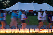 Pine Bush, New York - People from the Pine Bush community walk past luminaria during in the Relay for Life on Saturday, June 7, 2014. The Relay for Life is the American Cancer Society's largest fundraising event. ©Tom Bushey / The Image Works