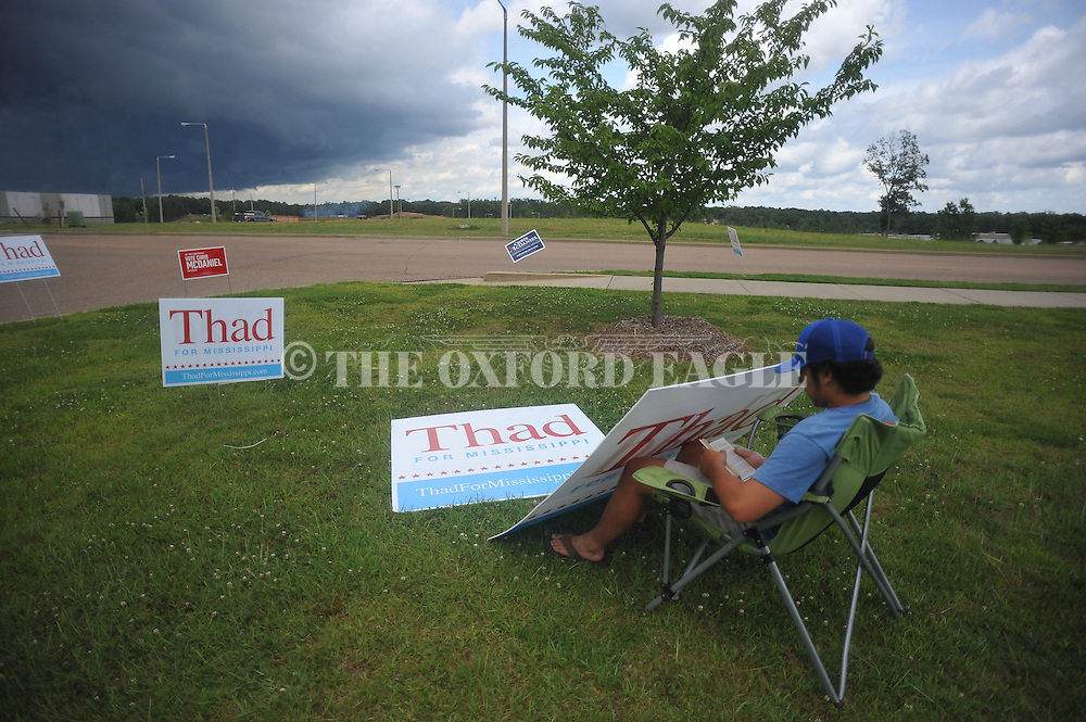 Malek Daghestani holds a Thad Cochran sign outside the voting booths at the Oxford Conference Center in Oxford, Miss. on Tuesday, June 24, 2014. Incumbent U.S. Senator Thad Cochran is being challenged by Chris McDaniel in a Republican runoff. The winner will face Democrat Travis Childers in the November general election. (AP Photo/Oxford Eagle, Bruce Newman)