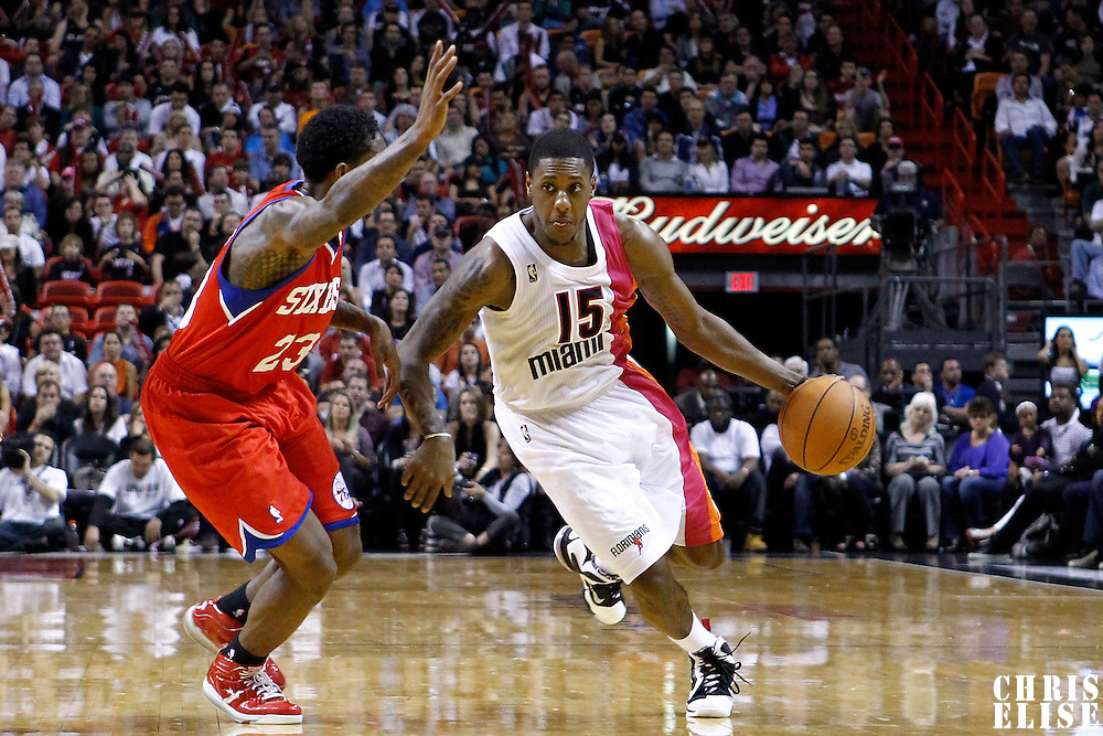 21 January 2012: Miami Heat point guard Mario Chalmers (15) drives past Philadelphia Sixers point guard Lou Williams (23) during the Miami Heat 113-92 victory over the Philadelphia Sixers at the AmericanAirlines Arena, Miami, Florida, USA.