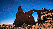 Turret Arch under the moonlight in Arches National Park in Moab, Utah.