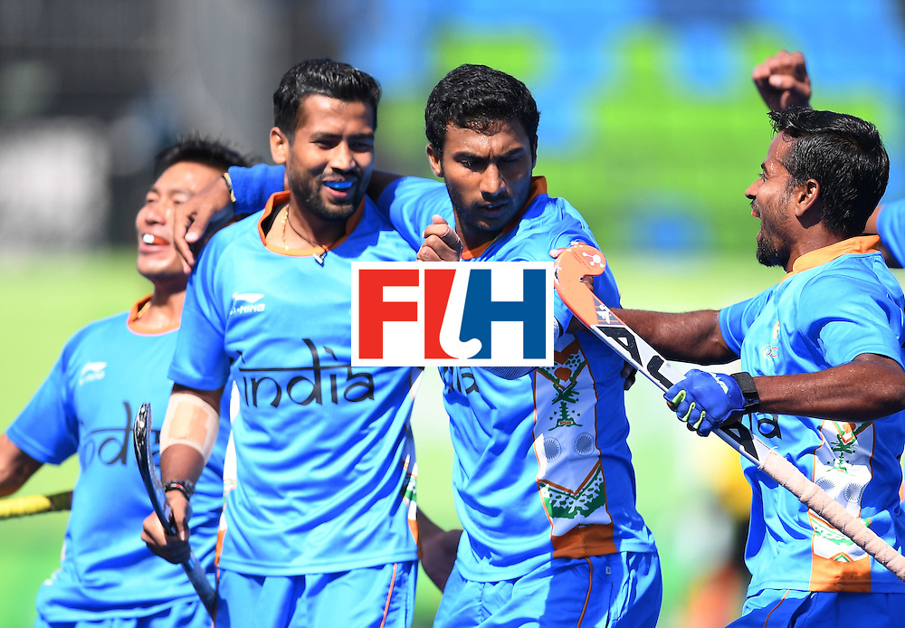 India's Raghunath Vokkaliga (2R) celebrates scoring a goal during the men's field hockey Netherland's vs India match of the Rio 2016 Olympics Games at the Olympic Hockey Centre in Rio de Janeiro on August, 11 2016. / AFP / MANAN VATSYAYANA        (Photo credit should read MANAN VATSYAYANA/AFP/Getty Images)