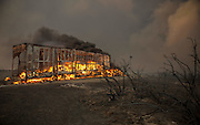 August 16, 2016 - California, U.S - A big rig burns on the Northbound 15 Freeway as the Blue Cut Fire rages through San Bernardino County Tuesday August 16, 2016. The fire has scorched at least 18,000 acres and forced 82,000 people to evacuate their homes in San Bernardino County. <br /> ©Exclusivepix Media