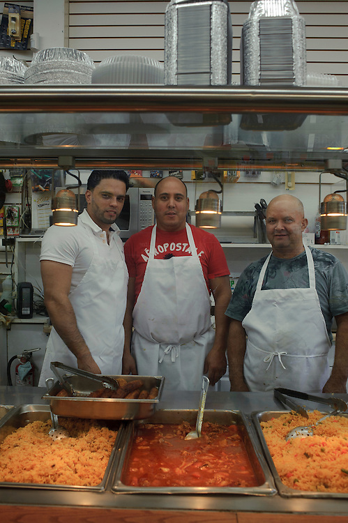 Juan Herrera, Nelson Espinal and Jose Morilla from Dominican Republic pose for the camera at their workplace Tropical Market II located in Brentwood. (July. 14, 2012)