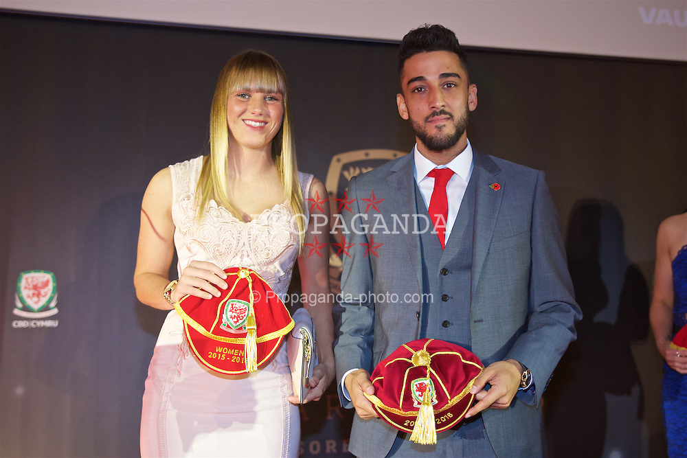 CARDIFF, WALES - Tuesday, November 8, 2016: Gemma Evans and Neil Taylor with their caps during the FAW Awards Dinner at the Vale Resort. (Pic by David Rawcliffe/Propaganda)