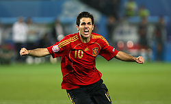 Cesc Fabregas of Spain celebrates after scoring the winning penalty  putting Spain through to the semi finals