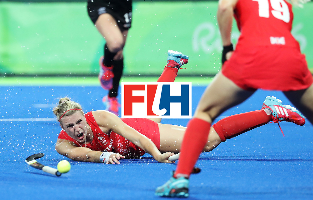 RIO DE JANEIRO, BRAZIL - AUGUST 17:  Lily Owsley #26 of Great Britain falls during the Women's Semifinal match between New Zealand and Great Britain on Day 12 of the Rio 2016 Olympic Games at the Olympic Hockey Centre on August 17, 2016 in Rio de Janeiro, Brazil.  (Photo by Rob Carr/Getty Images)