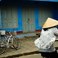 Girl riding a bicycle at Hoi An