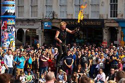 Edinburgh, Scotland, UK. 3 August 2019. On the first weekend of the Edinburgh Fringe Festival good weather brought out thousands of tourists to enjoy the many street performers  on the Royal Mile in Edinburgh Old Town. Iain Masterton/Alamy Live News