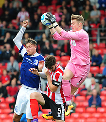 Lincoln City's Paul Farman out jumps team-mate Luke Waterfall to claim a high ball under pressure from Barrow's Richard Bennett<br /> <br /> Picture: Chris Vaughan/Chris Vaughan Photography<br /> <br /> Football - Vanarama National League - Lincoln City Vs Barrow - Saturday 17th September 2016 - Sincil Bank - Lincoln<br /> <br /> Copyright © 2016 Chris Vaughan Photography. All rights reserved. Unit 11, Churchill Business Park, Bracebridge Heath, Lincoln, LN4 2FF - Telephone: 07764170783 - info@chrisvaughanphotography.co.uk - www.chrisvaughanphotography.co.uk
