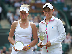 LONDON, ENGLAND - Sunday, July 3, 2011: Girls' Singles Champion Ashleigh Barty (AUS) (R) with runner-up Irina Khromacheva (RUS) after the Girls' Singles Final match on day thirteen of the Wimbledon Lawn Tennis Championships at the All England Lawn Tennis and Croquet Club. (Pic by David Rawcliffe/Propaganda)