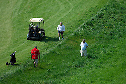 NORMANDY, FRANCE - MAY-01-2007 - Left to Right: Michel Laisnei of Normandy, France David Sabbag of Australia, and Dennis Picard of Normandy, France, search for a ball in the rough on hole 3 at the Omaha Beach Golf Club - Course: La Mer (The Sea) - Hole 3 - 356 yards - Par 4.  (Photo © Jock Fistick)