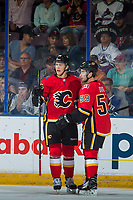 PENTICTON, CANADA - SEPTEMBER 10: Dillon Dube #59 of Calgary Flames celebrates a goal with a teammate against the Vancouver Canucks on September 10, 2017 at the South Okanagan Event Centre in Penticton, British Columbia, Canada.  (Photo by Marissa Baecker/Shoot the Breeze)  *** Local Caption ***