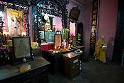 A monks tends a shrine at Emperor Jade Pagoda (Chua Ngoc Hoang or Phuoc Hai Tu), Ho Chi Minh City.
