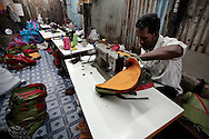 A man makes childrens backpacks in a small shop in Cheetah Camp. The slum of Cheetah Camp on the outskirts of Mumbai, India is a predominantly muslim community on living on the fringe while the city continues to grow.
