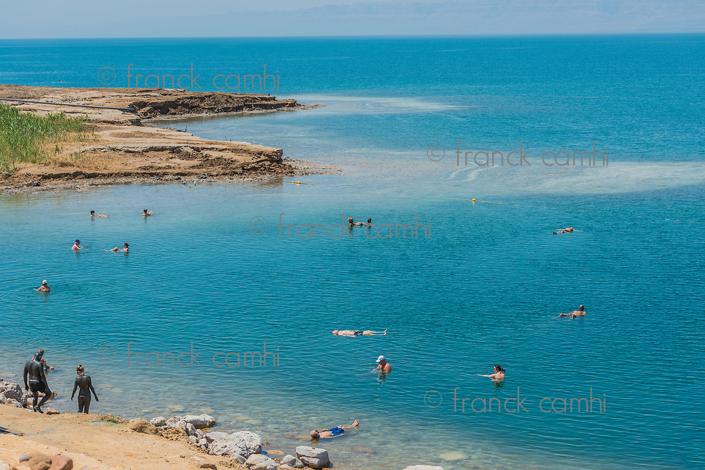 Dead Sea, Jordan - May 6, 2013 people swimming bathing in Dead Sea Jordan