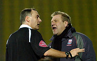 Photo: Leigh Quinnell.<br /> Watford v Stoke City. Coca Cola Championship.<br /> 14/01/2006. Stoke manager Johan Boskamp has strong words with referee Phil Crossley after his assistant Gerry Taggart was sent off.