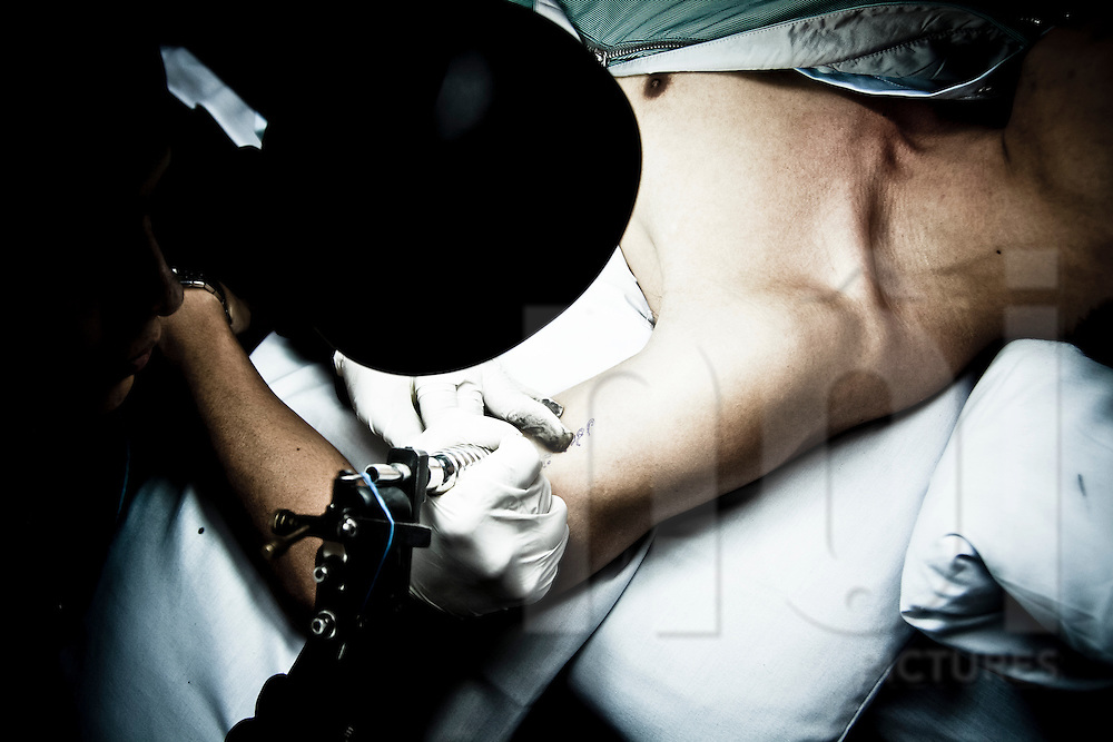 A man getting tattooed at the Hanoi Tattoo Club in Hanoi, Vietnam, Asia