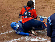 Hampton University Senior Brook Boykin reaches around Morgan State University Catcher Shareday Christina during the first game of Hampton's doubleheader split against Morgan State at the Lady Pirates Softball Complex on the campus of Hampton University in Hampton, Virginia.  (Photo by Mark W. Sutton)