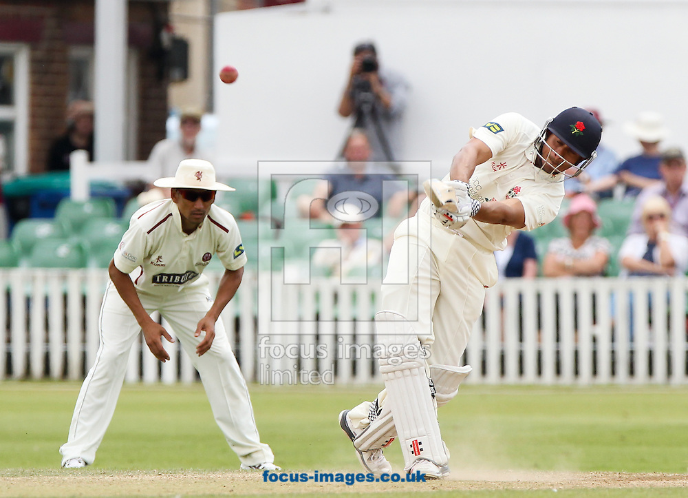 Usman Khawaja (right) of Lancashire County Cricket Club plays a shot during the LV County Championship Div One match at the County Ground, Taunton, Taunton<br /> Picture by Tom Smith/Focus Images Ltd 07545141164<br /> 02/07/2014