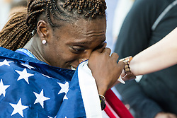 London, August 12 2017 . an emotional Dawn Harper Nelson, USA, wipes here eyes after meeting her proud mother Linda at the side of the track following her silver medal in the women's 100m hurdles final on day nine of the IAAF London 2017 world Championships at the London Stadium. © Paul Davey.