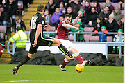 Northampton Town Striker James Collins dives into a tackle during the Sky Bet League 2 match between Northampton Town and York City at Sixfields Stadium, Northampton, England on 6 February 2016. Photo by Dennis Goodwin.