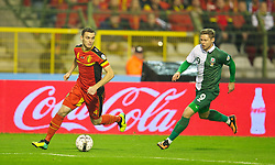 BRUSSELS, BELGIUM - Tuesday, October 15, 2013: Wales' Simon Church in action against Belgium's captain Thomas Vermaelen during the 2014 FIFA World Cup Brazil Qualifying Group A match at the Koning Boudewijnstadion. (Pic by David Rawcliffe/Propaganda)
