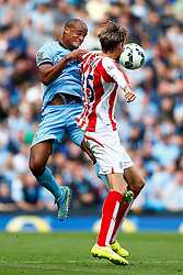 Vincent Kompany of Manchester City and Peter Crouch of Stoke compete in the air - Photo mandatory by-line: Rogan Thomson/JMP - 07966 386802 - 30/08/2014 - SPORT - FOOTBALL - Manchester, England - Etihad Stadium - Manchester City v Stoke City - Barclays Premier League.