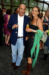GUY & ANDREA DELLAL at the annual Serpentine Gallery Summer Party co-hosted by Jimmy Choo shoes held at the Serpentine Gallery, Kensington Gardens, London on 30th June 2005.<br />