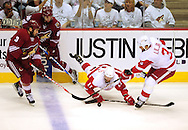 Apr 23, 2010; Glendale, AZ, USA; Phoenix Coyotes defenseman Keith Yandle (3) , Detroit Red Wings right wing Daniel Cleary (11) and Detroit Red Wings defenseman Andreas Lilja (3) battle for the loose puck during the second period of game five in the first round of the 2010 Stanley Cup Playoffs at Jobing.com Arena.  Mandatory Credit: Jennifer Stewart-US PRESSWIRE