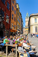 Sweden, Stockholm. Stortorget with Stockholm Stock Exchange and Storkyrkan in the background.
