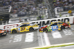 September 22, 2018 - Richmond, Virginia, United States of America - Kyle Busch (18) battles for position during the Federated Auto Parts 400 at Richmond Raceway in Richmond, Virginia. (Credit Image: © Chris Owens Asp Inc/ASP via ZUMA Wire)