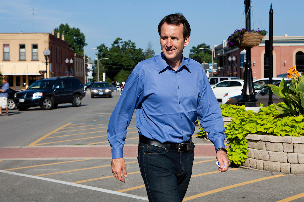 Republican presidential hopeful Tim Pawlenty, right, leaves a campaign stop on Tuesday, July 26, 2011 in Washington, IA.
