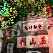 Vietnamese characters carved into a stone gate on the northern shore of Hoan Kiem Lake in Hanoi, Vietnam.