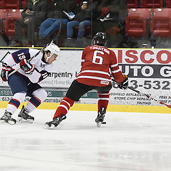 WELLINGTON, - Dec 11, 2015 -  Exhibition Game 2- Team USA vs Team Canada East at the 2015 World Junior A Challenge at the Wellington District Community Centre, ON. Liam Pecararo #19 of Team United States battles for the puck with Derek Topatigh #6 of Team Canada East during the third period.<br /> (Photo: Andy Corneau / OJHL Images)