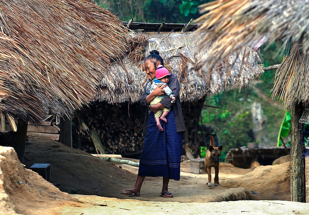 A Hmong woman with a baby in Luang Namtha, Laos.