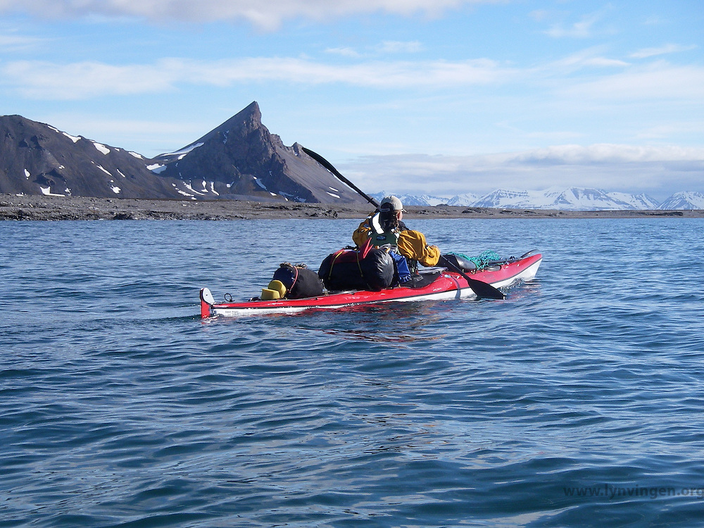 A kayaker passing by outside the Mitra peninsula at Spitzbergen