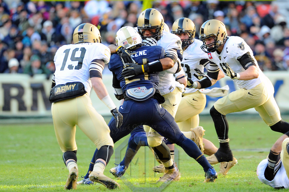 10 December 2011:   Army Black Knights linebacker Geoffrey Bacon (6) tackles Navy Midshipmen running back Gee Gee Greene (21) at Fed Ex field in Landover, Md. in the 112th annual Army Navy game where Navy defeated Army, 27-21 for the 10th consecutive time.